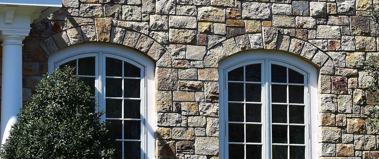 natural stone veneer house exterior , gray, brown