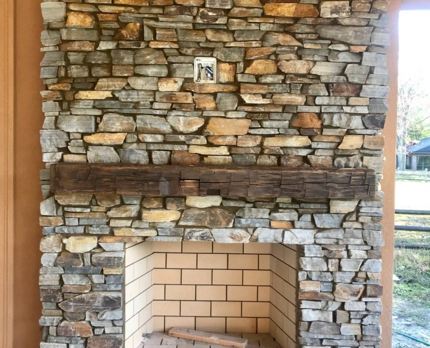 natural stone fireplace copper gray brown